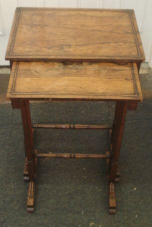 A nest of two Regency rosewood tables, from a quartetto, the rectangular tops on dual turned end standards and trestle bases, the largest, 44cm.