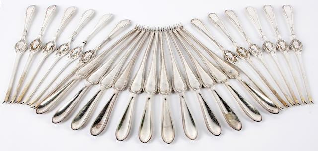 A set of twelve German silver coloured lobster picks
