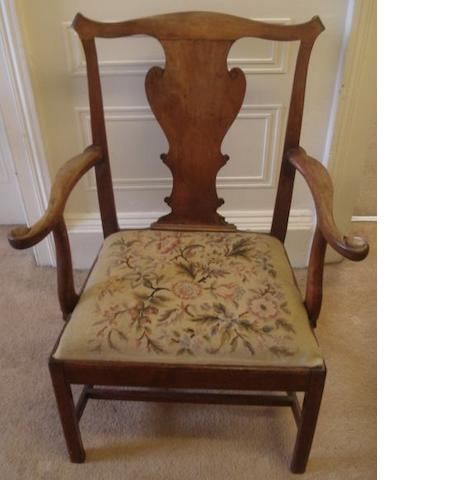 A George III mahogany elbow chair, with vase shaped back splat, woolwork drop-in seat on square moulded supports.