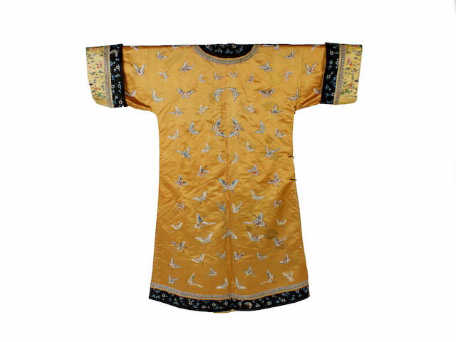 A Chinese golden yellow embroidered silk satin robe, 19th century
