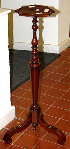 A reproduction William and Mary style torchere,