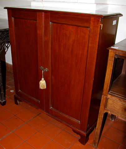 A small mahogany dwarf cupboard, 87cm wide.
