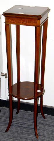 An Edwardian inlaid mahogany plant stand,