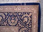 A Ghom silk rug, Central Persia, 194cm x 130cm