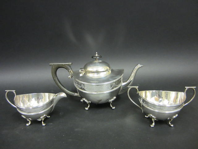A silver three piece tea service by William Aitken, Birmingham 1919