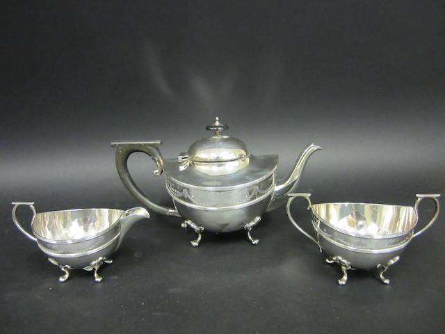 A three piece silver tea service by William Aitken, Birmingham 1919  (3)