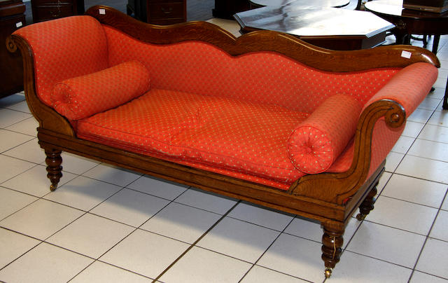 A Victorian oak scroll end serpentine settee