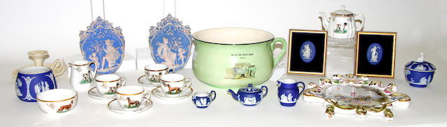 A Leeds pottery creamware chamberstick, a German part tea set, a continental wall plaque, a chamber pot and a group of jasperware
