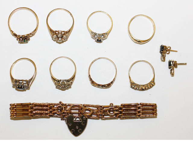 A collection of rings and a gate link bracelet