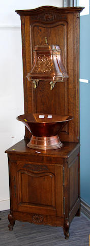 A French oak water fountain,