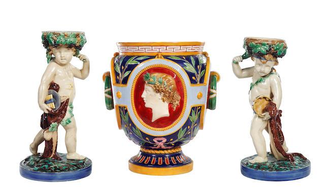A Minton majolica jardinière, and a pair of Minton majolica figural pedestals, circa 1870-80