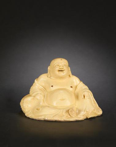 A glazed stoneware, probably provincial, figure of Budai
