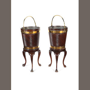 A pair of George III Irish mahogany peat buckets