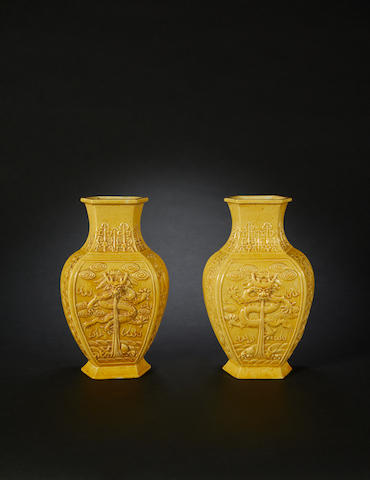 A pair of yellow monochrome vases
