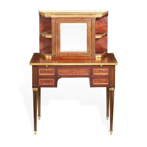 A French late 19th century brass mounted mahogany bonheur du jour in the Directoire style