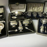 A six piece silver cruet set,  by Walker and Hall,  Birmingham 1934,   (7 cases)