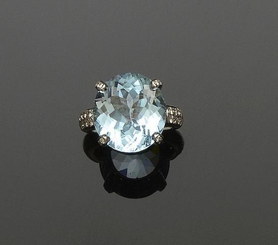 A blue topaz and diamond dress ring