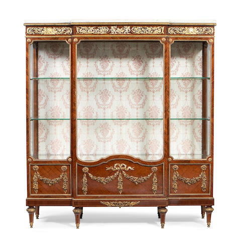 A French late 19th/early 20th century Louis XVI style gilt bronze mounted kingwood and parquetry breakfront vitrine