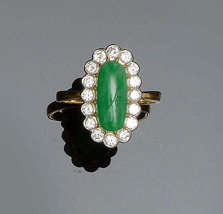 An 18ct gold mounted jade and diamond ring