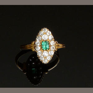A marquise-shaped emerald and diamond ring