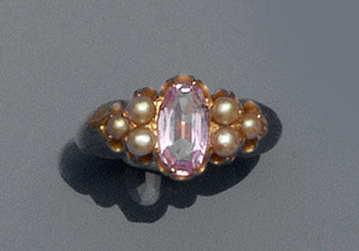 A pink topaz and half pearl ring