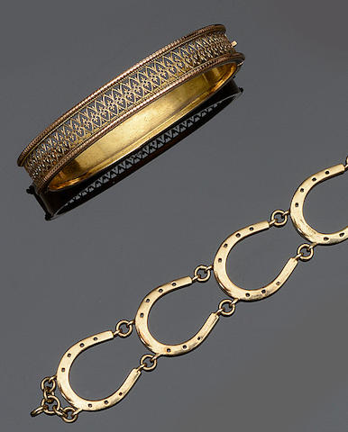 A pierced bangle and a horseshoe bracelet (2)