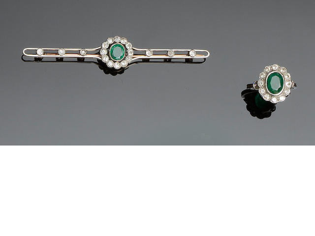 An emerald and diamond cluster ring and an emerald and diamond bar brooch  (2)