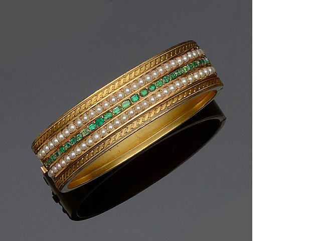 An emerald and half pearl bangle