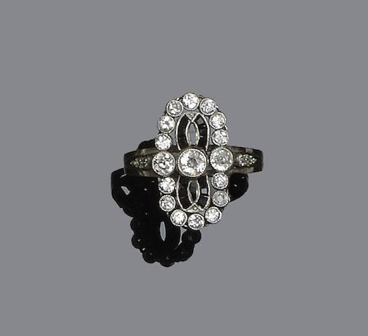A diamond and onyx panel ring