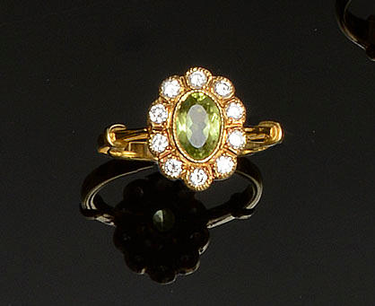 A peridot and diamond cluster ring
