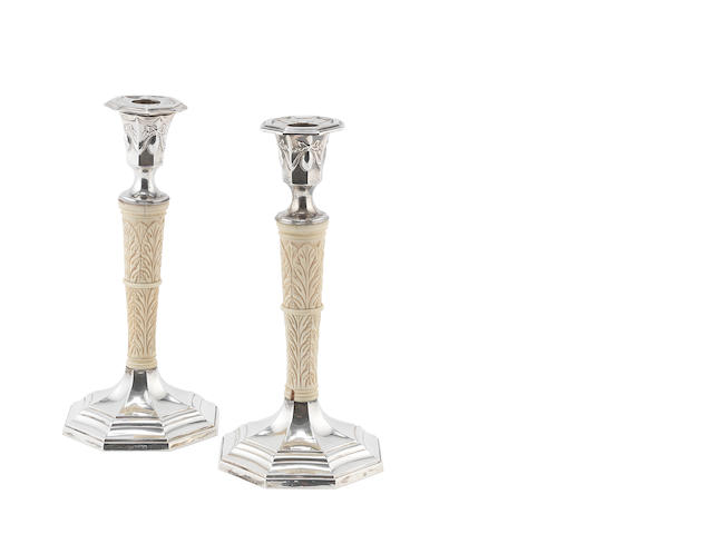 A pair of silver and ivory candlesticks