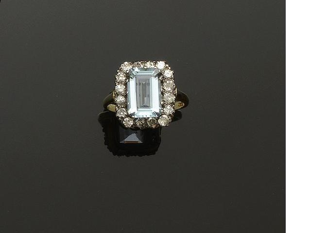 An aquamarine and diamond rectangular cluster ring