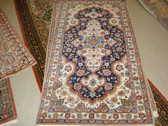 A pair of Tabriz rugs, North West Persia, 191cm x 94cm (2)