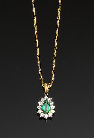 An 18ct gold emerald and diamond pendant
