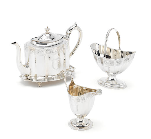 A George III silver three-piece tea service with teapot stand by Charles Aldridge, the cream jug with no distinguishable maker's mark, London 1794  (4)