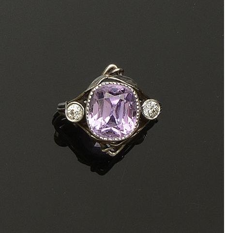 British: An Arts and Crafts pink sapphire and diamond ring