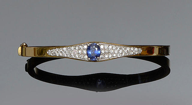 A sapphire and diamond set bangle