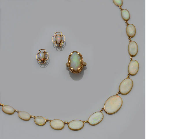 A matched opal necklace, earclips and ring suite (3)