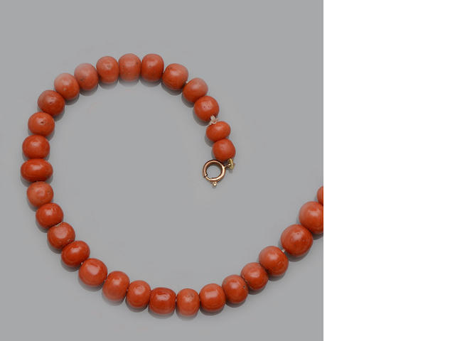 A coral bead necklace, a Victorian hinged bangle and a bead necklace (3)