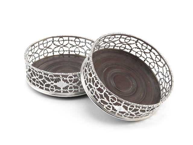 A pair of Irish silver coasters, by Christopher Haines of Dublin, circa 1790
