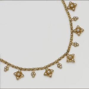 A gold and seed pearl necklace