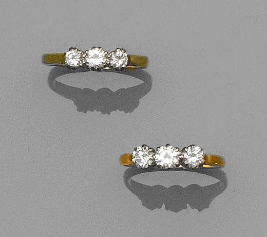 Two diamond three stone rings (2)