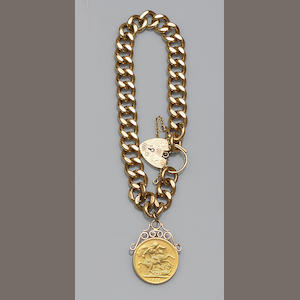 A 9ct gold curb-link bracelet with sovereign pendant