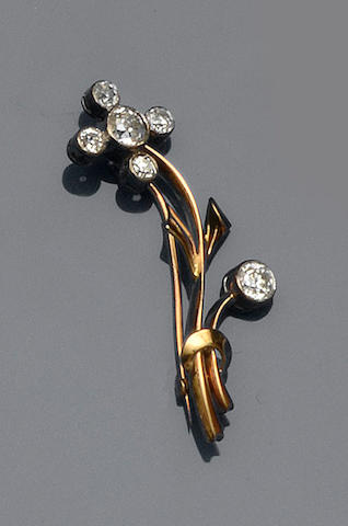 A diamond stylised flower brooch