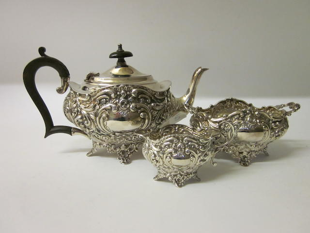 A Victorian silver three piece tea service,  Birmingham 1899,  (3)
