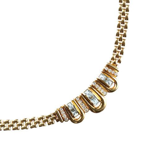A topaz and diamond set necklace