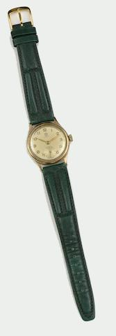 Rolex: A lady's 9ct gold wristwatch  (2)