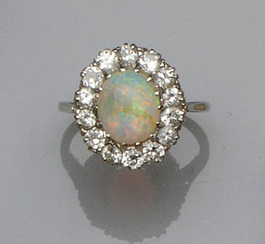 An opal and diamond cluster ring and a fancy-link chain (2)