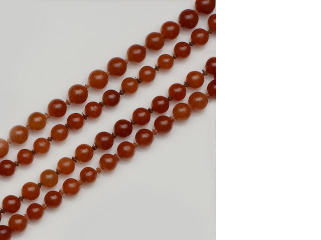 A brown/russet jade bead necklace