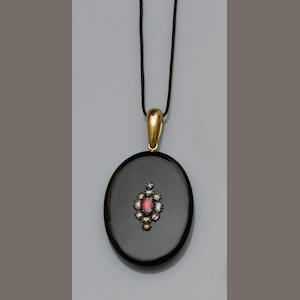 A mourning ebonite and gem-set locket pendant,